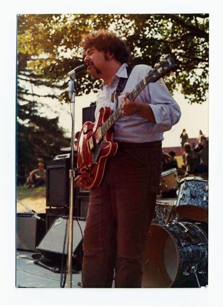 Mike Robillard on stage with the original four piece Roomful of Blues at the Vietnam Moratorium Day gathering in Wilcox Park, Westerly, Rhode Island, October 15, 1969 (Image appears courtesy the Larry and Linda Peduzzi Collection)