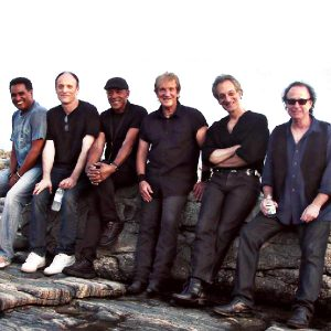 "The Beaver Brown Band 2015 (left to right): Jackie Santos, Dean Cassell, Michael ""Tunes"" Antunes, John Cafferty, Gary ""Guitar"" Gramolini & Steve Burke"
