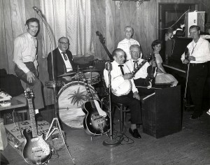 Dick Leger at left next to his trademark guitar; his wife, Sue Durfee, is on piano at the right