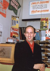 Carl Henry at the first location of his Carl's Diggins record shop adjacent to The Celebrity Club. (Schiavone/Henry Family Archive)