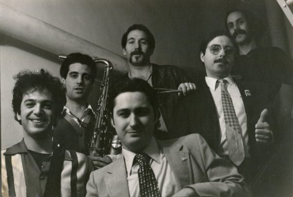 "The Bluetones in transition: One of the several lineups which would constitute the band during the mid-1970s after the departure of Ronnie Earl. Left to right: Peter ""Hi-Fi"" Ward, Mark ""Kaz"" Kazanoff, Steve Brown, Anthony Geraci, Michael ""Muscat"" Ward and, in front, Raymond ""Sugar Ray"" Norcia"