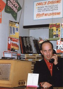 Carl Henry behind the counter at the original Carl's Diggins shop adjacent to The Celebrity Club. (Schiavino Family Archive)